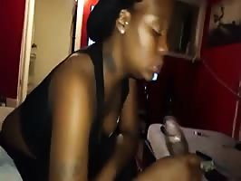 Ebony wife treating her man to an afternoon sucking session
