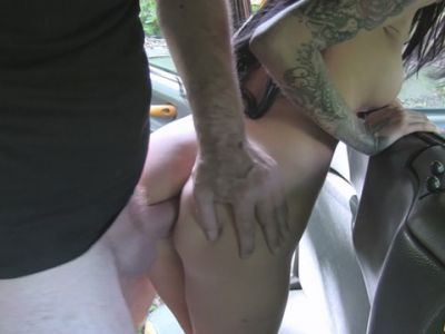 Busty tattooed lady gets her asshole fucked in the cab