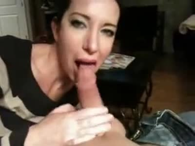 Brunette lady sucks massive cock