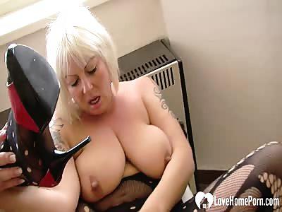 Blonde MILF in stockings pleasures her snatch